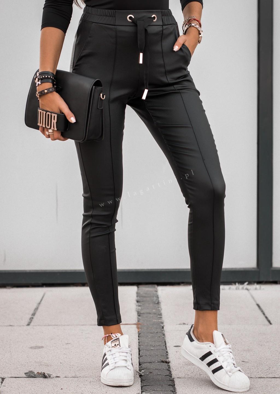 fajne czarne woskowane spodnie