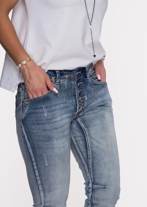 Włoskie jeansy PRZESZYCIA GUZIKI jasny jeans
